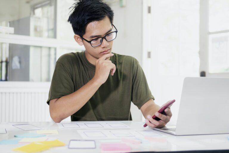 Web designer, UX UI designer designing mobile application user interface.